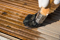 Staining decking a close up of using stain on wooden Royalty Free Stock Photography