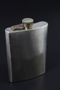 Stainless hip flask on black background Stock Image