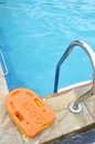 Stainless ladder in the pool with blue water Royalty Free Stock Photo