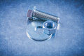 Stainless screwbolt bolt washer and screw-nut on metallic surfac Royalty Free Stock Photo