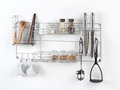 Stainless shelf with kitchen utensil Royalty Free Stock Photography