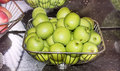 stock image of  Stainless steel basket of green apples