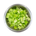 Stainless steel bowl filled with chopped celery Stock Image