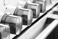 Stainless steel cooker knobs close up image of Stock Photography