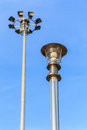 Stainless steel lamp pole at the road on blue sky Royalty Free Stock Photo