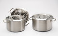 Stainless steel pots with white background studio shot Royalty Free Stock Images
