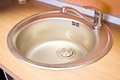 Stainless steel sink on the kitchen Stock Photography