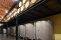 Stainless steel wine vats in a row inside the winery Stock Images