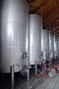 Stainless steel wine vats in a row inside the winery Royalty Free Stock Images