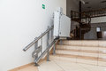 Stair lift for the disabled. Stairs of public building Royalty Free Stock Photo