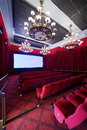 Staircase baffle and seats in cinema hall red with big lusters Royalty Free Stock Image