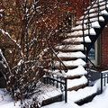 Staircase covered by snow during a sudden snowstorm in montreal canada photo taken with iphone Royalty Free Stock Photo