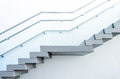 Staircase ladder going up on wall background Stock Photo