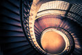 Staircase in spiral or swirl shape, fibonacci golden ratio composition, abstract or architecture concept, dark vintage mysterious Royalty Free Stock Photo