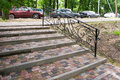 Staircase with steps of paving slabs metal railing Stock Images