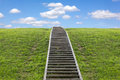 Staircase to heaven huge stairway leading up a green hill Royalty Free Stock Photos