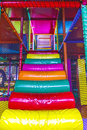 Staircases of the indoor playground arena for kids with ball guns bumpers punching cylinder slide bridge balls Stock Photography