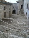 Staircases of stones in descent in a characteristic town of the Puglia in Italy Royalty Free Stock Photo