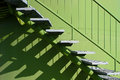 Stairs with balustrade and shadows by a windmill Stock Photo