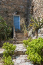 Stairs and blue entrance door corsica to residentual home with sant antonino mountain village calvi haute corse france europe Royalty Free Stock Images