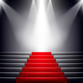 Stairs covered with red carpet. Royalty Free Stock Photo