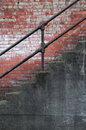 Stairs with Iron Railing and Old Brick Wall Royalty Free Stock Photo