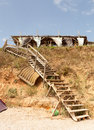 Stairs leading down on the beach from a restaurant in vama veche black sea romania Royalty Free Stock Photos