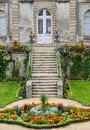 Stairs leading to castle entrance and flower parterre Stock Photography
