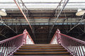 Stairs leading up under an old truss roof Royalty Free Stock Photo