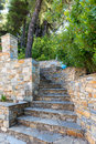 Stairs of natural stone leading into the woods