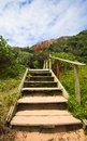 Stairs old wooden and dilapidated leading down to the beach at the heads in knysna eastern cape south africa Royalty Free Stock Images