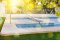 Stairs of a swimming pool in garden Royalty Free Stock Photo