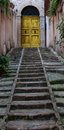 Stairs to door yellow traditional italian in the medieval town Royalty Free Stock Images