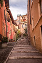 Stairs to the hill with Castle Saint Pietro Royalty Free Stock Photo