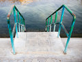 Stairs to the water of the swimming pool Royalty Free Stock Photo