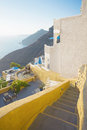 Stairs to yellow Santorini terrace, Greece Royalty Free Stock Images