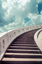Stairs towards blue sky with clouds Royalty Free Stock Photo