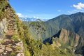 Stairs of trail with Machu Picchu far below in the