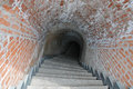 Stairs and underground old passage to an in the wall of a fortress Royalty Free Stock Image