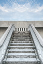 Stairs of white stonemason bridge against the blue cloudy sky bottom view during summer day Royalty Free Stock Photos