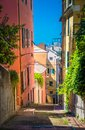 Stairway between multicolored buildings with colorful walls Royalty Free Stock Photo