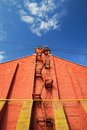 Stairway on red brick wall on clear blue sky Royalty Free Stock Photo
