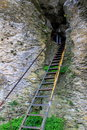 Stairway to the cave anchored in rocks and rail safety Stock Photography