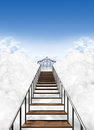 Stairway to heaven a depiction of the heavens pearly gates above the clouds on a clear blue sky background Royalty Free Stock Image
