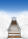 Stairway to heaven a depiction of the heavens pearly gates above the clouds on a clear blue sky background Stock Photo