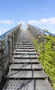 Stairway to heaven steel staircase going up to a blue sky with clouds concept of the road the road success modern Stock Photography