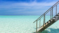 Stairway to paradise into the turquoise indian ocean on the maldives Royalty Free Stock Photography