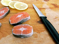Stakes of salmon on board Royalty Free Stock Images