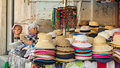 Stall of hats on the road Royalty Free Stock Photos
