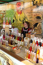 A stall with syrups and flavoring in bottles Royalty Free Stock Photography